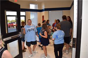 Visitors with Kingsland t-shirts enter the new lobby of the Kingsland school.
