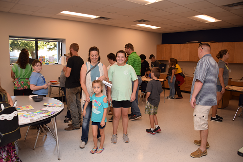 Several visitors walked the hallways of the new Kingsland school.