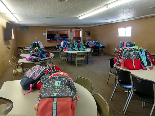 photo of backpacks on table