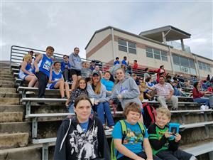 Group photo of Kingsland students sitting in stands at Regional Cross Country Meet.
